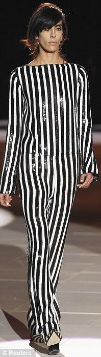 Shine: A vertical stripe all-in-one look resembles the appearance of a mute performer