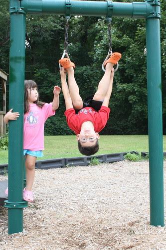 Adam hangs upside down