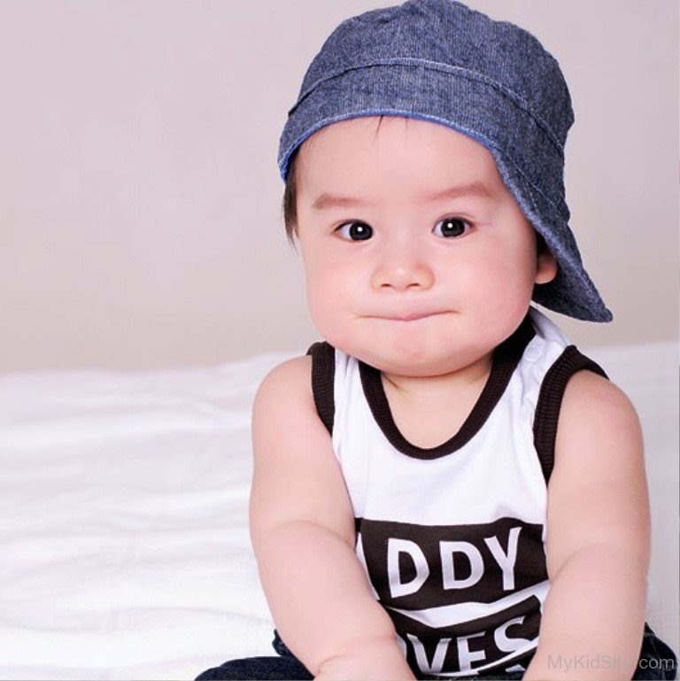 Cute Baby Boy Wearing Blue Cap