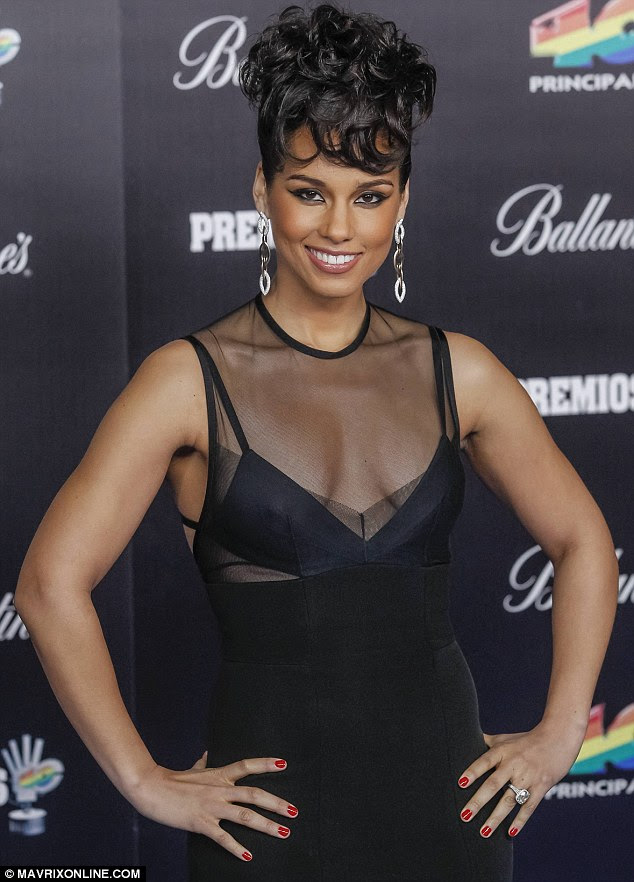 Siren: Alicia Keys looked like she'd stepped from a film noir in her sensuous attire for the 40 Principles Awards Photocall held at El Palacio de los Deportes in Madrid, Spain on Thursday