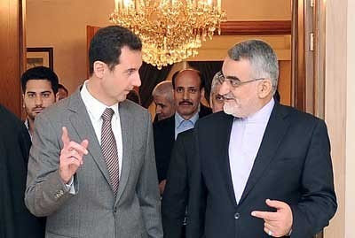 Syrian President Bashar al-Assad with Alaeddin Boroujerdi of the National Security Committee at the Shura Council in the Islamic Republic of Iran. The two Middle Eastern states maintain fraternal relations. by Pan-African News Wire File Photos