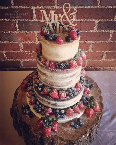 Naked wedding cake. Layers of chocolate fudge, red velvet