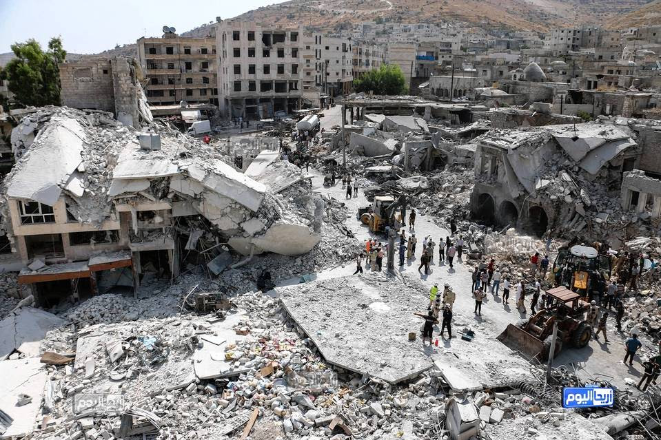 This photo, provided by the Syrian antigovernment activist group Ariha Today, shows the scene after a government warplane crashed in the center of Ariha in northwestern Syria on Monday, Aug. 3.