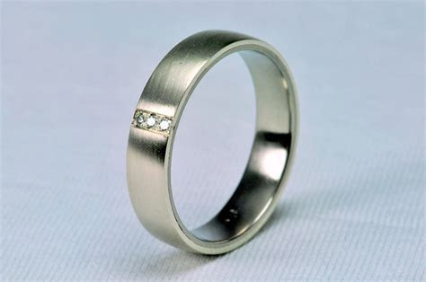 mildly convex wedding ring, inside titanium, outside white