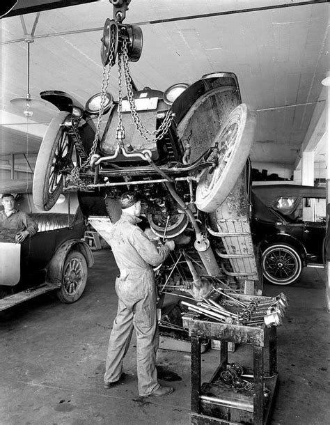 Mechanic working on a Buick. | Old auto repair shops
