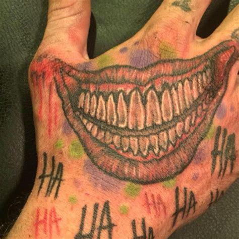 joker smiley face hand tattoo tattoo ideas