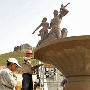 Workers from the People's Democratic Republic of Korea (DPRK) finishing the African Renaissance Monument in Senegal. It is a representation of the historical struggle and contributions of the African peoples. by Pan-African News Wire File Photos