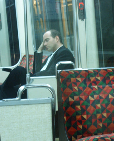Man asleep on the District Line