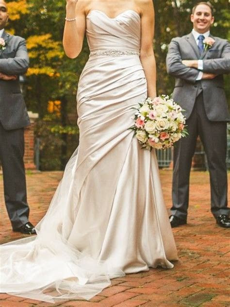 Oyster wedding dress with grey groom suit and cream/ivory
