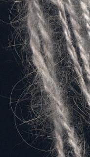 Loosely spun Angora yarn with halo.