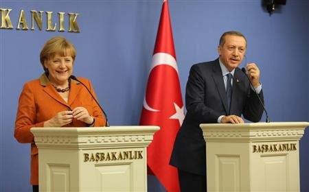 German Chancellor Merkel and Turkey's Prime Minister Erdogan attend a joint news conference in Ankara