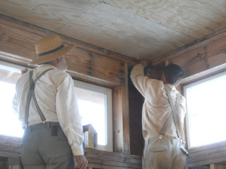 Fellowship Men Helping Put Up Corner Ceiling Panel