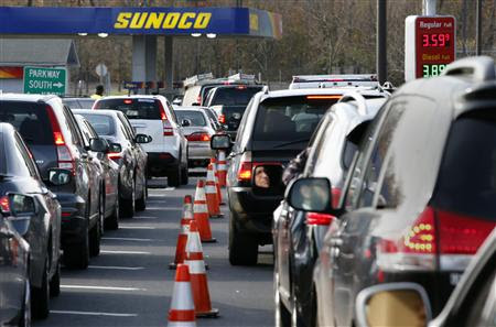 Cars wait in long lines at a Sunoco gas station on the Garden State Parkway in Montvale New Jersey