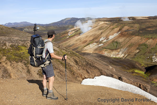 06D-1209 Hiker Looking Towards Volcanic Steam Vents in the Starihver Geothermal Area on the Laugavegur Hiking Trail Fjallabak Iceland.