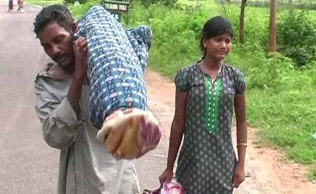 Image result for orissa man carries his dead wife on his shoulder