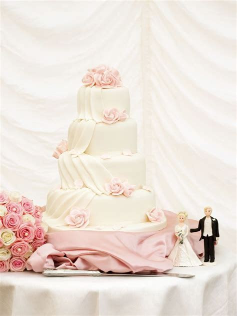 4 tier ivory fondant wedding cake with fondant draping