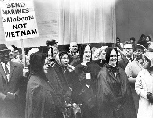 Mrs. Rosa Parks (c) with the Sisters of St. Joseph from Madonna School  during a  Detroit demonstration for voting rights for blacks in Alabama on March 10, 1965. by Pan-African News Wire File Photos