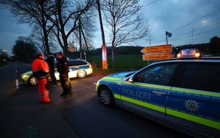 Police near the Borussia Dortmund team hotel after the explosion