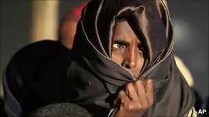 A Somali woman waits to register at Dagahaley Camp, outside Dadaab, Kenya (13 July 2011