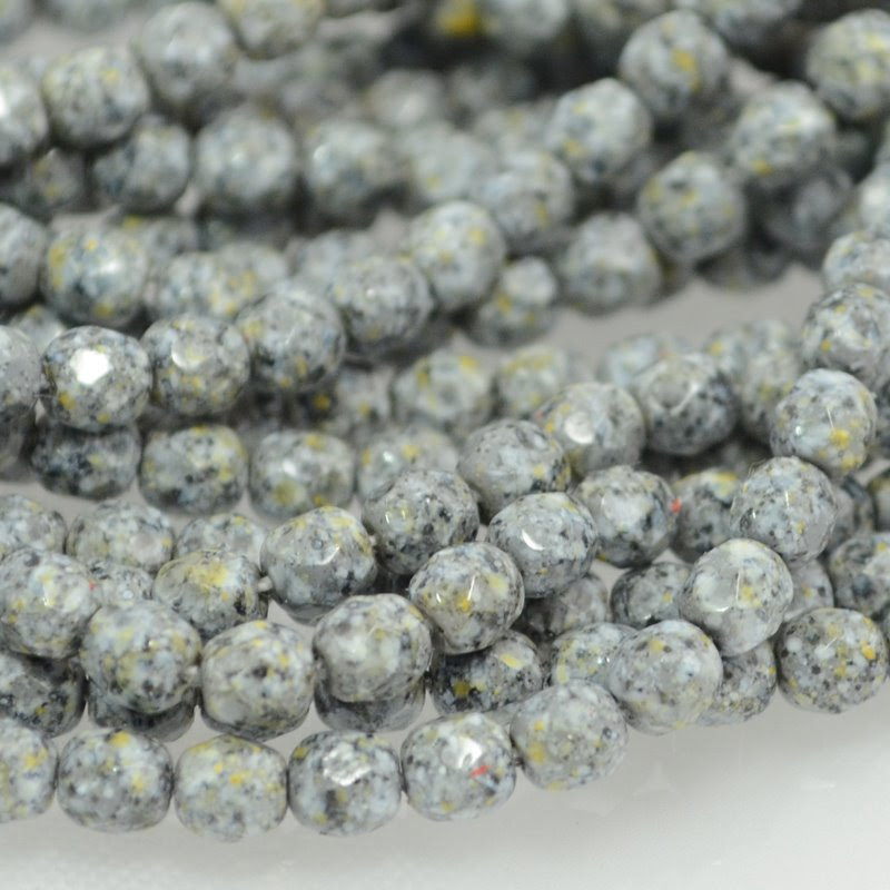 s39957 Firepolish - 4 mm Faceted Round - Granite Speckle (50)