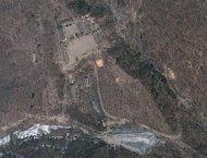 This April 18, 2012 satellite image provided by GeoEye appears to show a train of mining carts, at the lower center of the frame, and other preparations underway at North Korea's Punggye-ri nuclear test site but no indication of when a detonation might take place, according to analysis by the U.S.-Korea Institute at Johns Hopkins School of Advanced International Studies. (AP Photo/GeoEye)