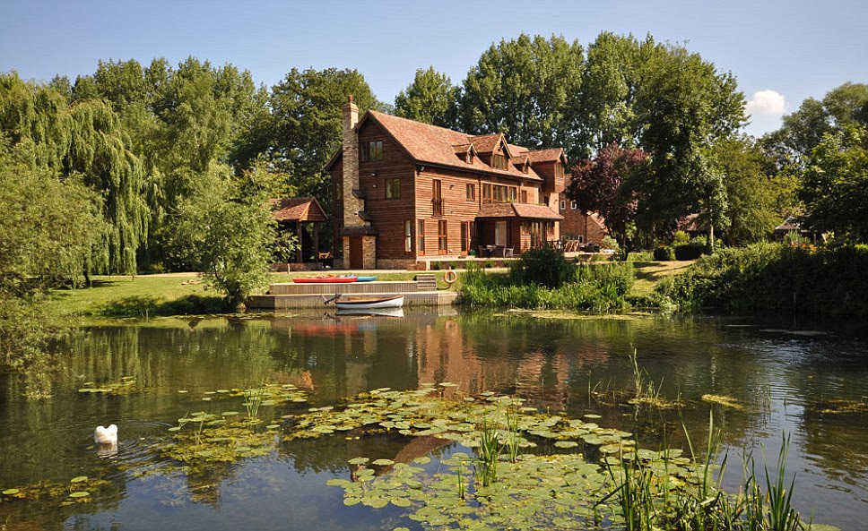 The stunning Tempsford Mill in Bedfordshire which overlooks the River Ivel and includes 6.5 acres of land. It also includes a renovated old mill, a newer extension and outbuildings