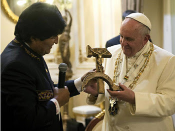 Francis receiving a hammer and sickle from Bolivia's leader