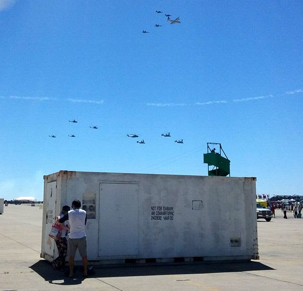 A fleet of Marine Corps aircraft fly over the main airfield at MCAS Miramar after a combat demo...on September 24, 2016.