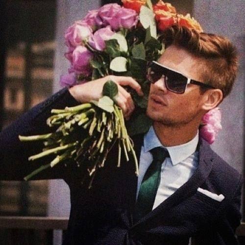 Risultati immagini per boy with flowers