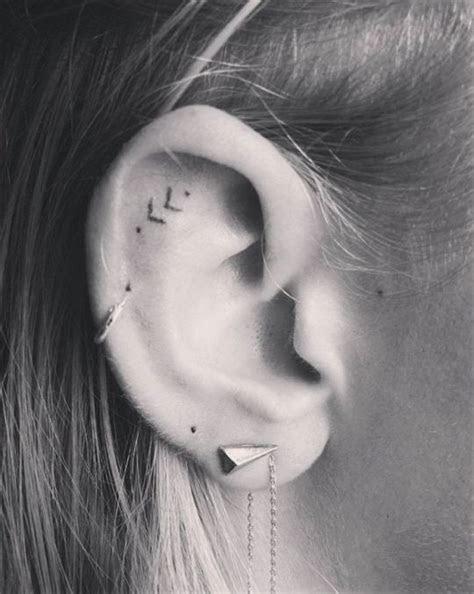 tiny ear tattoos perfect minimalists