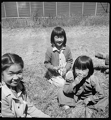 San Bruno, California. Young evacuees at this assembly center are happy to get their pictures taken., 06/16/1942