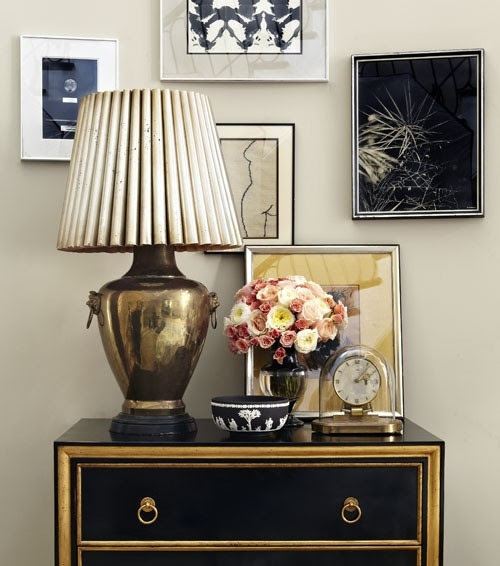 black & gold vignette with black chest with gold leaf trim, brass hardware