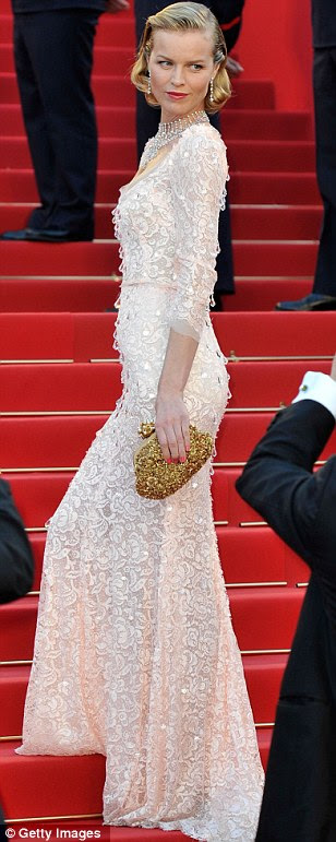 Regal elegance: Eva Herzigova wore a beautiful oyster pink gown embellished with a subtle white pattern