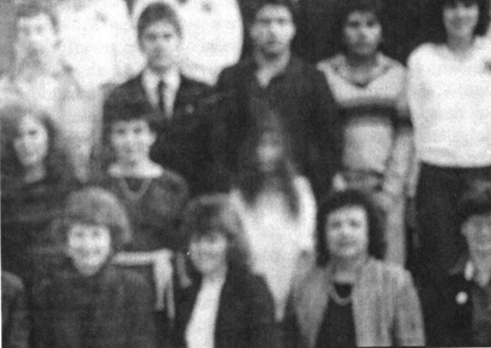 1986 Graduating class - The girl on white was not in the original negative but is in the developed photo. No one knows who she is. (From the El Paso High public pictures)