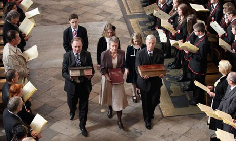 Ancient copies of the King James Bible are carried during a procession at Westminster Abbey
