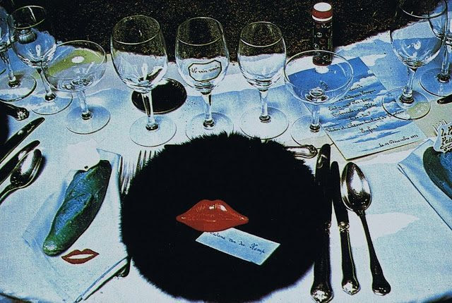 1972 Surrealiste Ball Detail of a table with a fur dish, Mae West red lips and a blue bread