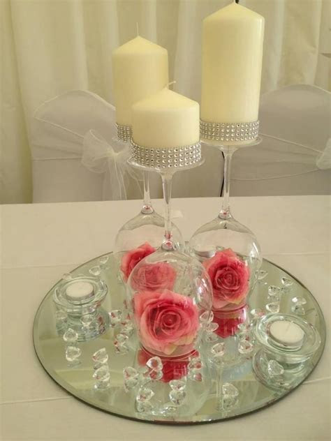 Pink flower upside down wineglass centerpiece   W Ideas in