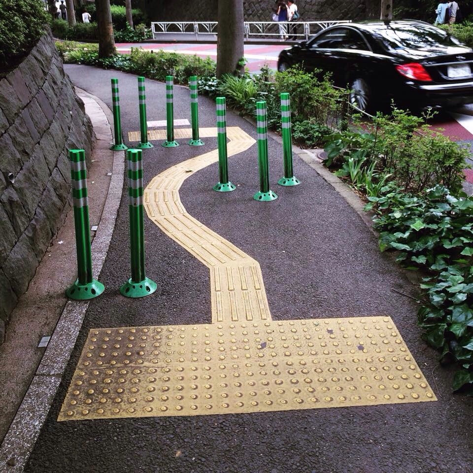 Sidewalk with a chicane to slow down cyclists (or fast walkers). Japan