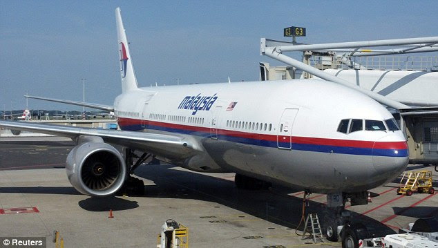 The Malaysia Airlines Boeing 777 seen at the G3 gate of Schiphol Airport in Amsterdam, before it took off, heading to Kuala Lumpur, on July 17