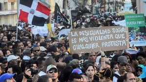 """Nov. 11 protest in Santo Domingo, Dominican Republic. The sign reads """"Social inequality is more violent than any protest."""" by Pan-African News Wire File Photos"""