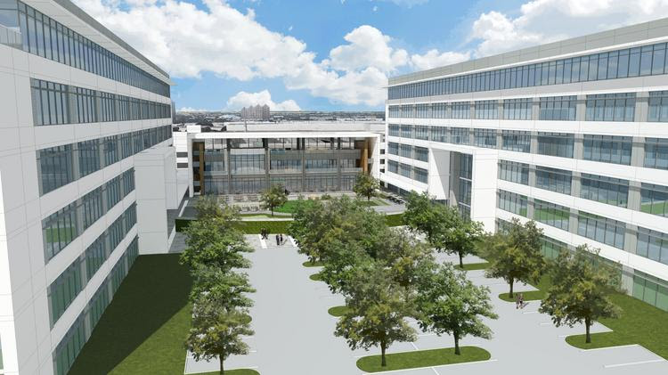 The two six-story office buildings will connect with 'The Hub,' a three-story amenity building.
