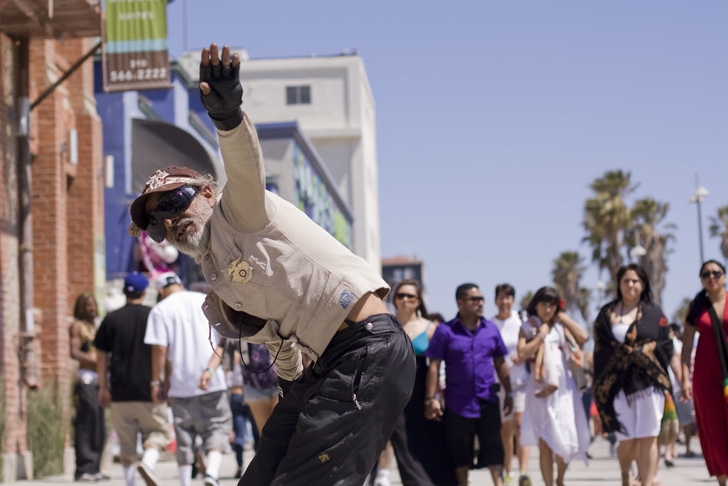 Man dancing to the beat of a drum circle