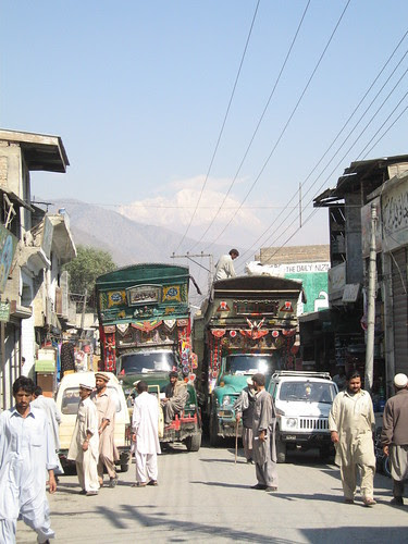 Traffic jam, Chitral town with Tirich Mir in the background