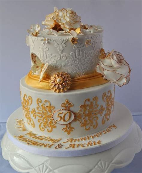 2 tier round white 50th anniversary cake with butterflies