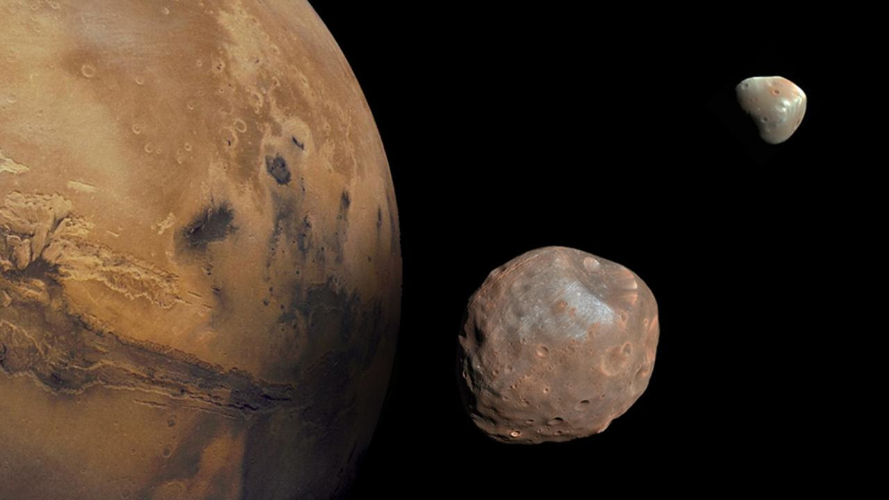 Mars along its moons Phobos and Deimos.