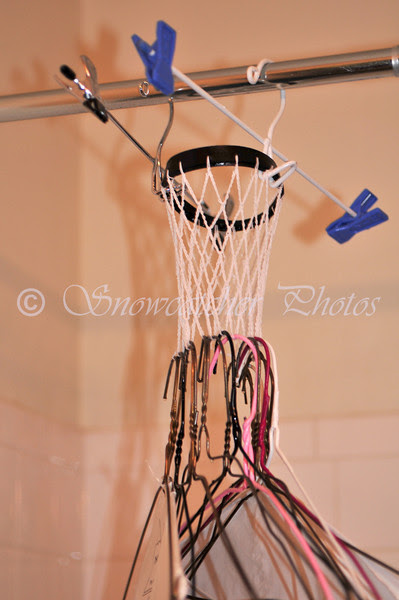 Use clothes hangers to weight the net overnight.