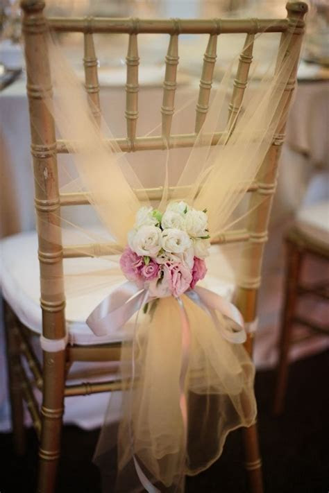 Tulle chair decor. A Romantic Capella Wedding filled with