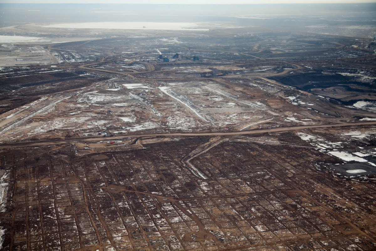 Clearing, dewatering, and seismic grid over the once boreal forest. Syncrude mining site, Alberta, Canada.