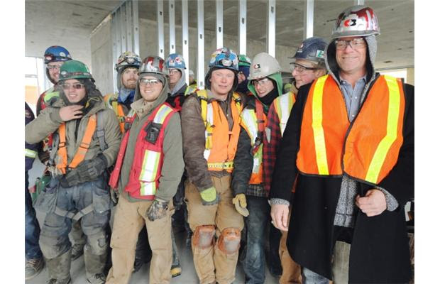 Mike Holmes with the construction workers at the new Boyle Renaissance Senior's project phase 2 on December 21, 2012 in Edmonton.
