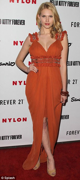 Classy girl: Hart Of Dixie actress Claudia Lee looked stunning in a floor length orange dress